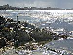 Zonlicht schittert op het water, de Uisken baai, Schotland