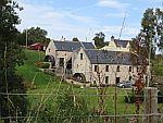 Watermolens langs Aldie Water, Schotland