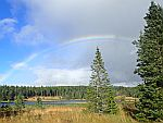 Regenboog boven Pronie Loch, Schotland