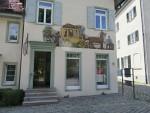 Postkoets op een gevel in Salem, Duitsland
